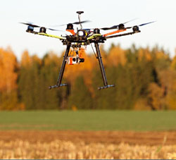 Drone hovering over a field