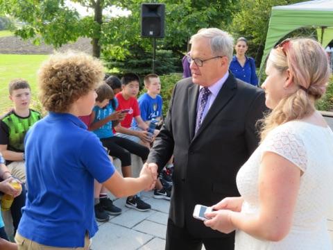 Min MacAulay meeting Hawthorne Public School grade 8 student Thomas Davidson