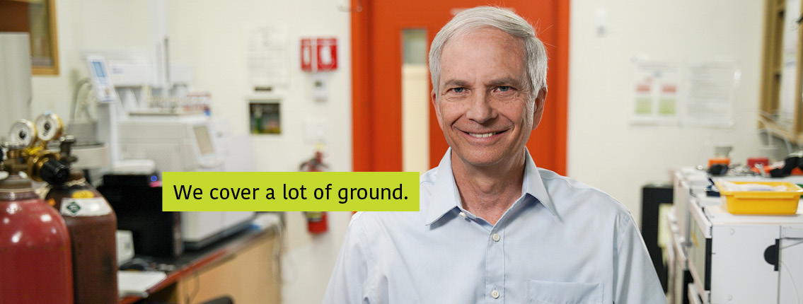 Charles Forney in his laboratory. Text: We cover a lot of ground.